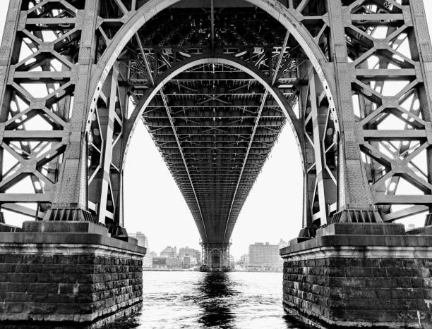 New York City Underneath the Williamsburg Bridge in Lower Manhattan. arch architectural feature stock pictures, royalty-free photos & images