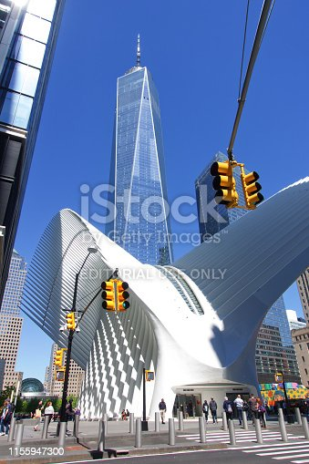 New York City, USA - 05/11/2019: The image shows a part of the financial district in Manhattan. At this picture you see the One World Trade Center and the WTC Oculus. The One World Trade Center was opened at  November 2014, the architecture was made by Skidmore, Owings and Merrill (SOM). The WTC Oculus was created by the architect Santiago Calatrava Valls and opened at the 3rd March 2016.