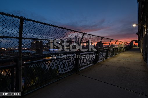 Manhattan Bridge pedestrian path at sunset.