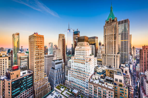 New York City New York City Financial District cityscape at dusk. manhattan financial district stock pictures, royalty-free photos & images