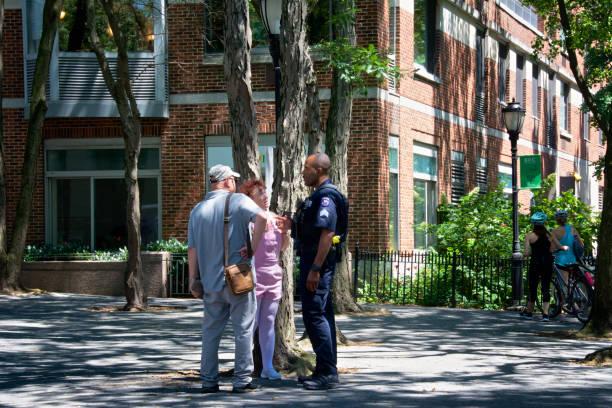 NYPD - New York City Police Officer Assisting Senior Couple, Manhattan, New York City, USA stock photo