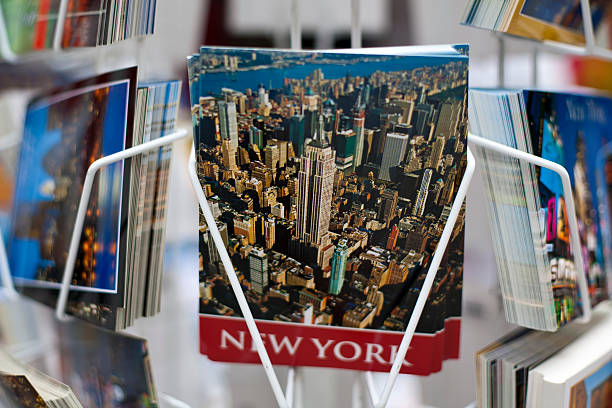 New York City postcards New York, USA - September 02, 2012: New York City postcards displayed on a rack for sale from a souvenir shop in Manhattan. magazine rack stock pictures, royalty-free photos & images