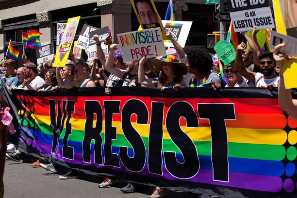 new york city pride parade - protesting trump - trump foto e immagini stock