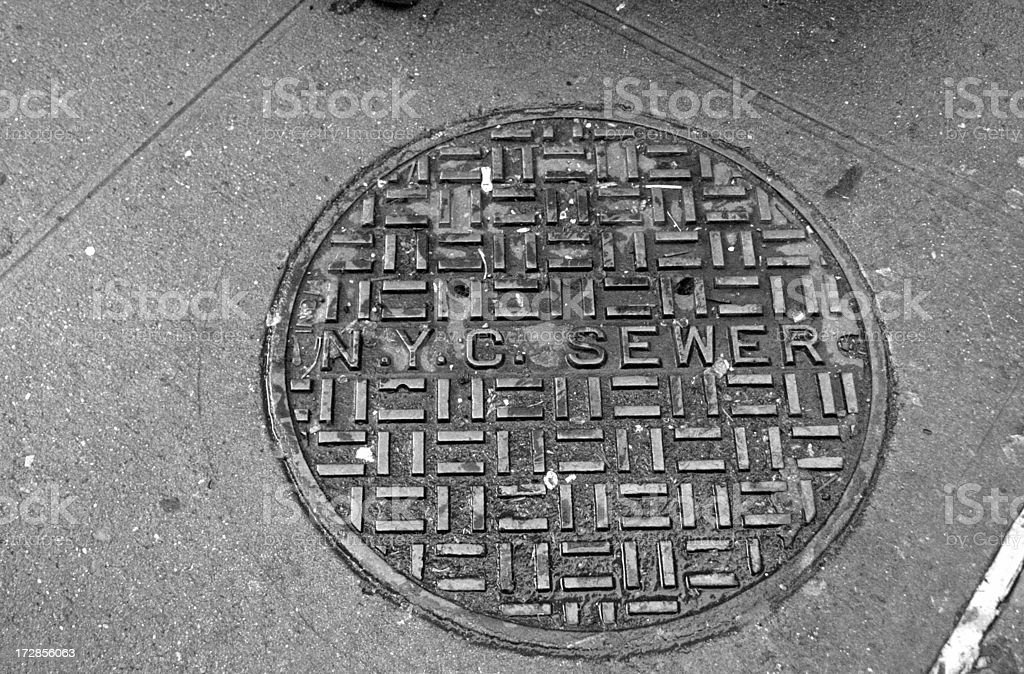 New York City Sewer hole stock photo