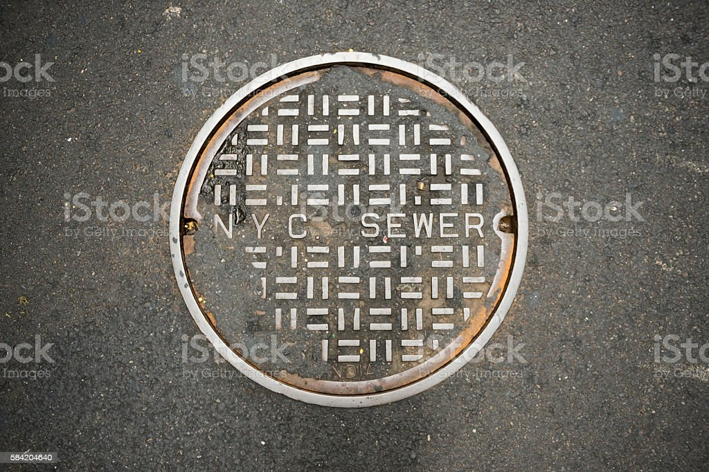 New York City sewer manhole cover stock photo