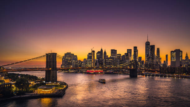New York City skyline and Brooklyn Bridge at sunset Beautiful sunset over Lower Manhattan. new york city stock pictures, royalty-free photos & images