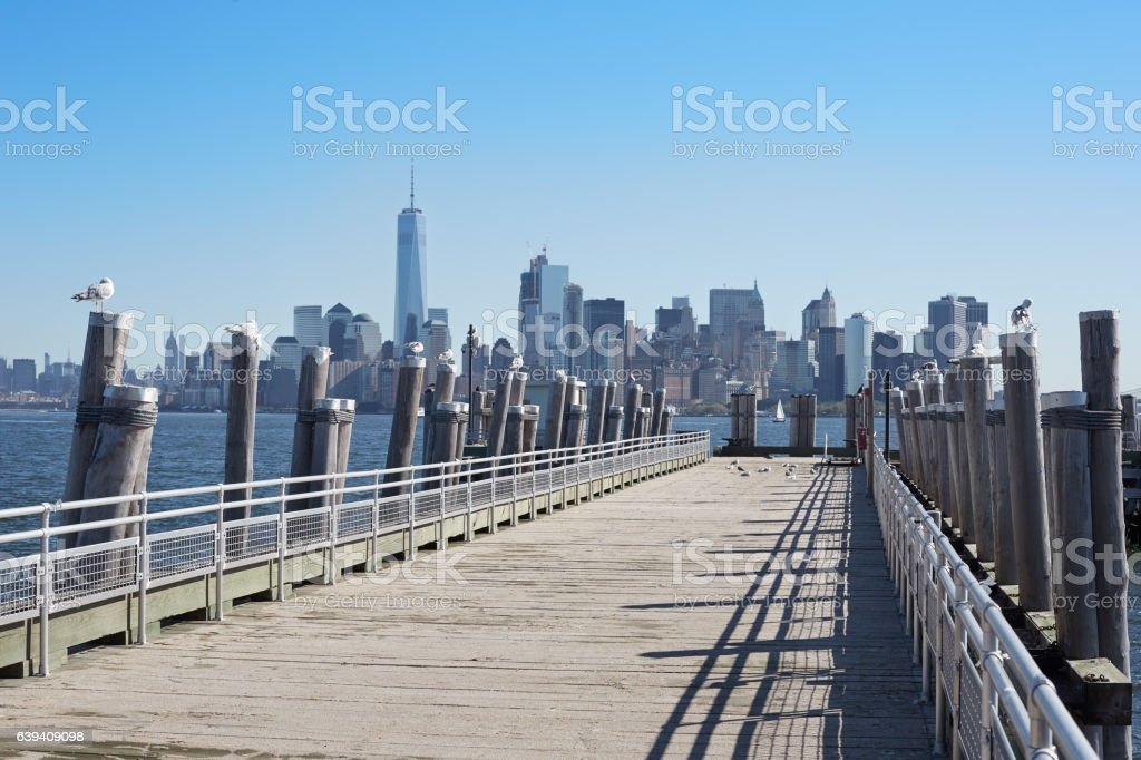 New York city skyline and empty pier with seagulls stock photo