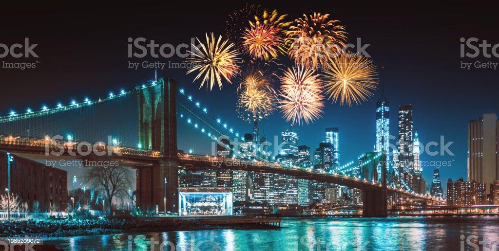 new york city skyline at night with fireworks stock photo