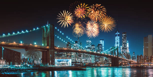new york city skyline at night with fireworks new york city skyline at night with fireworks independence day holiday stock pictures, royalty-free photos & images