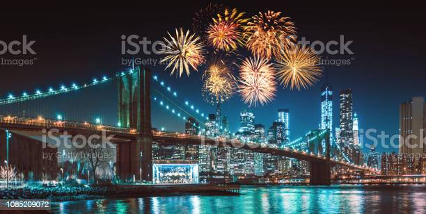 new york city skyline at night with fireworks