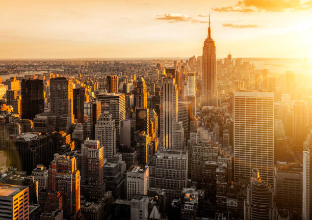 New York city skyline at sunset New York city skyline at sunset new york state stock pictures, royalty-free photos & images