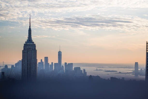 New York City Skyline Buildings Sunset New York City Skyline Buildings Sunset Empire State Building new york state stock pictures, royalty-free photos & images