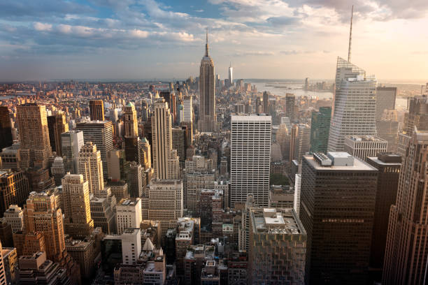New York City skyline New York City skyline with urban skyscrapers at sunset, USA. new york state stock pictures, royalty-free photos & images
