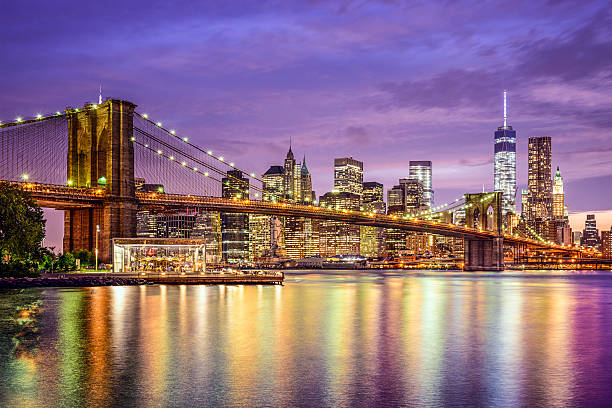 New York City Skyline New York, New York, USA city skyline with the Brooklyn Bridge and Manhattan Financial District over the East River. manhattan financial district stock pictures, royalty-free photos & images