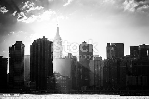 Black and white shot of the Empire State Building and the New York City skyline