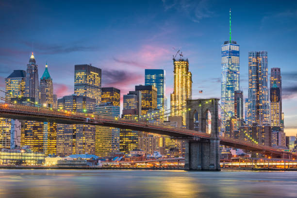 New York City Skyline New York City, USA skyline on the East River with Brooklyn Bridge at dusk. new york state stock pictures, royalty-free photos & images