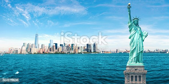 Amazing NYC Skyline with Statue of Liberty, One World Trade Center, Empire State Building, Brooklyn and Manhattan Bridges.