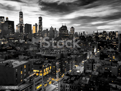 istock New York City skyline view at night with yellow lights contrasted against the black and white buildings 1193133237