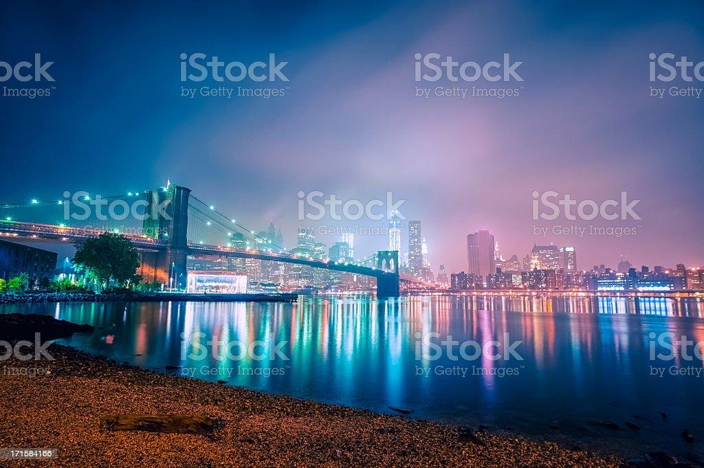 New York City skyline with Brooklyn bridge by night royalty-free stock photo