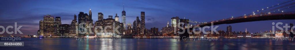 New York city skyline with Brooklyn bridge panorama at dusk stock photo