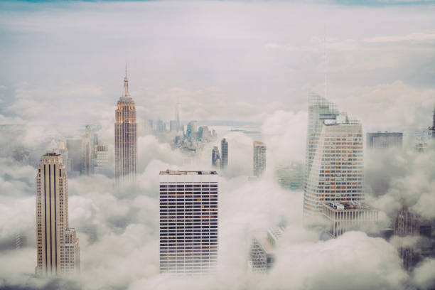 new york city skyline with clouds - clouds imagens e fotografias de stock