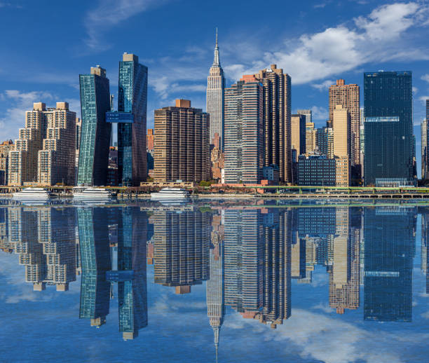New York City Skyline with Empire State Building and Skyscrapers of Manhattan East Side Reflected in East River in the Morning. stock photo