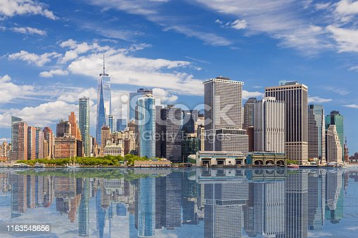 New York City Skyline with Manhattan Financial District, World Trade Center, Battery Park, Staten Island Ferry Terminal and Water of New York Harbor, NY, USA. This image was taken with Canon EF 24-105mm F/4L IS lens and Canon EOS 6D full frame DSLR.