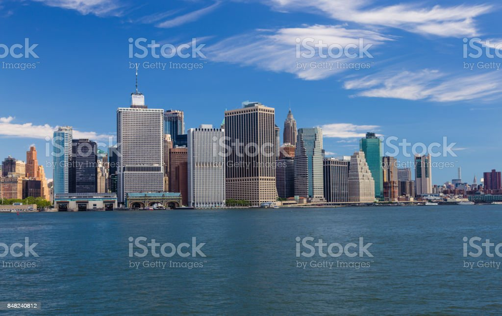 New York City Skyline with Manhattan Financial District, Water of New York Harbor, FDR Drive and Blue Sky. stock photo