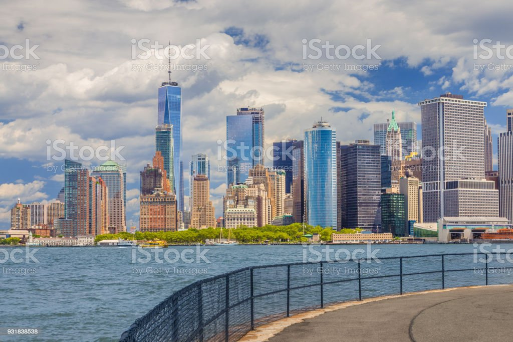 New York City Skyline with Manhattan Financial District, World Trade Center, Water of New York Harbor, Battery Park, Staten Island Ferry Terminal and Blue Sky. stock photo