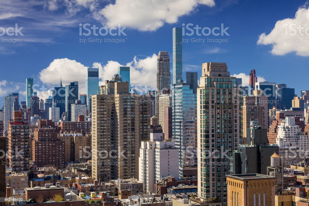 New York City Skyline with Upper East Side and Midtown Luxury Condominium Highrises, Small Footprint Tall Towers and Vivid Blue Sky. stock photo
