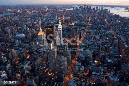 516768600 istock photo New York City Skyscrapers at Night 1204591711