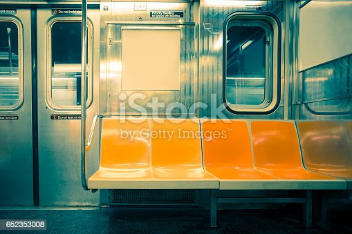 New York City seats on empty subway train car with vintage tone filter