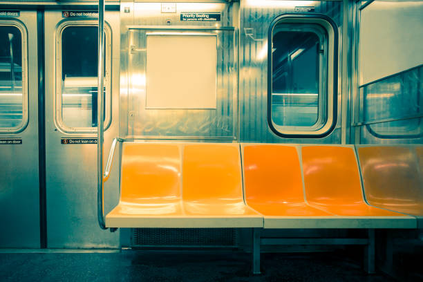 New York City Subway Seats New York City seats on empty subway train car with vintage tone filter subway stock pictures, royalty-free photos & images
