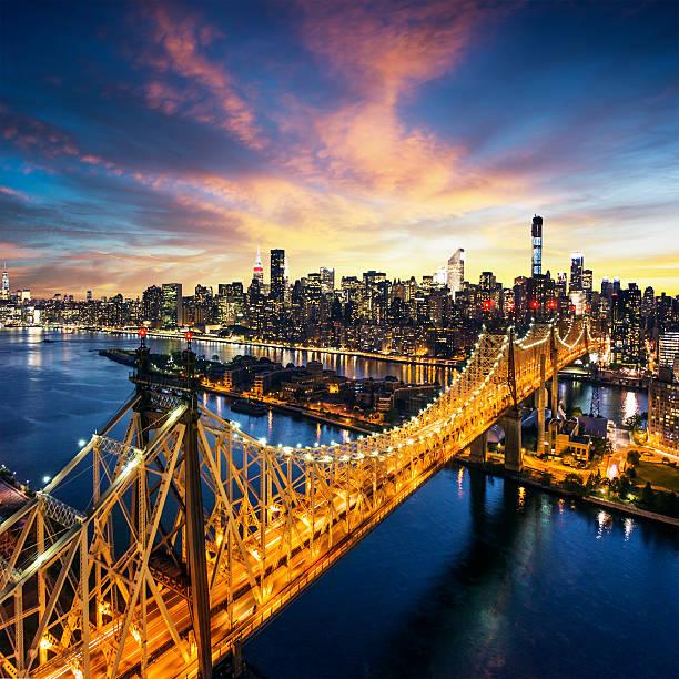 New York City sunset over manhattan with Queensboro bridge stock photo