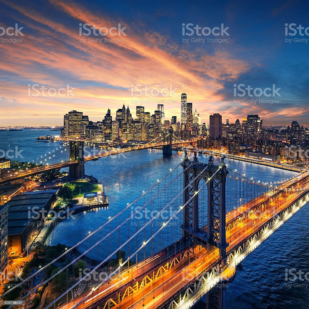 New York City sunset with manhattan and brooklyn bridge stock photo