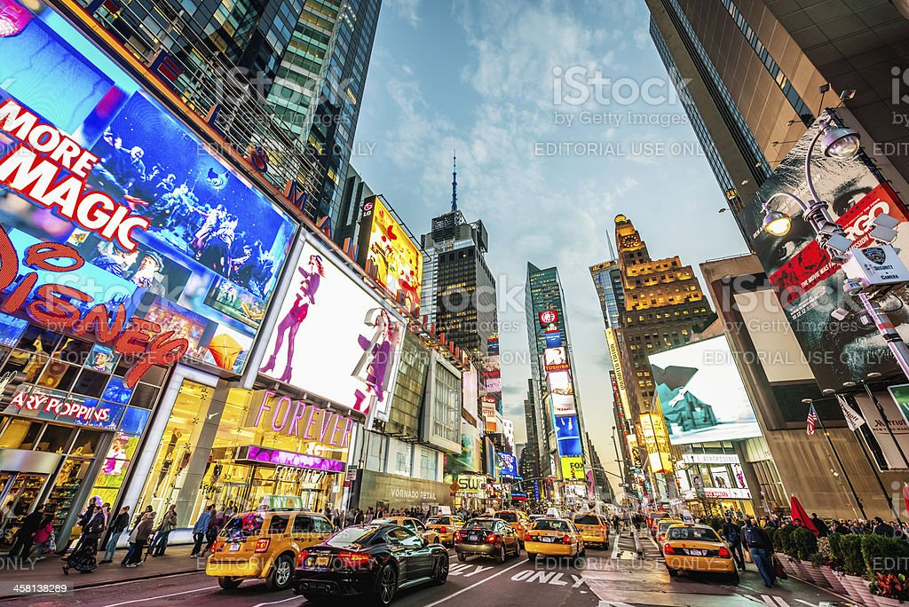 """New York City Times Square Traffic """"New York, USA - October 10, 2012: Yellow cabs and crowds of tourists moving along famous and illuminated Time Square in Manhattan, NYC, USA at night."""" Advertisement Stock Photo"""