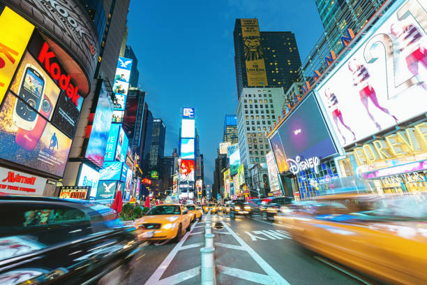 new york city times square yellow cab traffic - times square stock photos and pictures