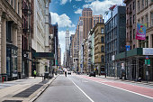 istock New York City, United States - May 2 2020: street road in Manhattan at summer time. Urban big city life concept background 1227450544