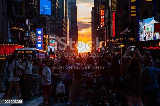New York City / USA - JUL 13 2018: Manhttanhenge street view from Times Square at rush hour in midtown Manhattan