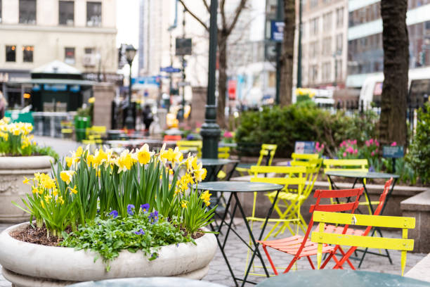 New York City, USA street view of urban NYC Herald Square Midtown with Greeley Square Park chairs tables and nobody by korea town koreatown stock photo