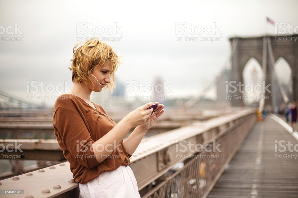 New York City woman using a smartphone royalty-free stock photo