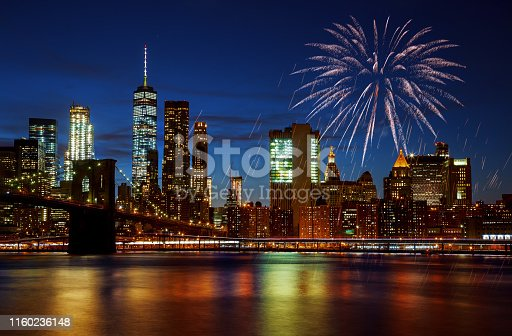 istock New York City's Brooklyn Bridge and Manhattan skyline illuminated amazing fireworks in Independence day 1160236148
