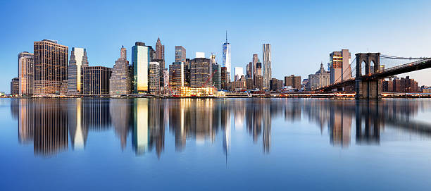 New York downtown panorama with brooklyn bridge and skyscrapers New York downtown panorama with brooklyn bridge and skyscrapers manhattan financial district stock pictures, royalty-free photos & images