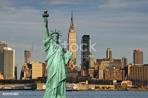 new york cityscape skyline empire state building and statue of liberty