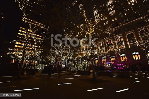 New York, USA, November 30, 2019. Christmas lights in Zuccotti Park formerly Liberty Plaza Park near World Trade Centers Memorial in Financial District of Lower Manhattan, NY.