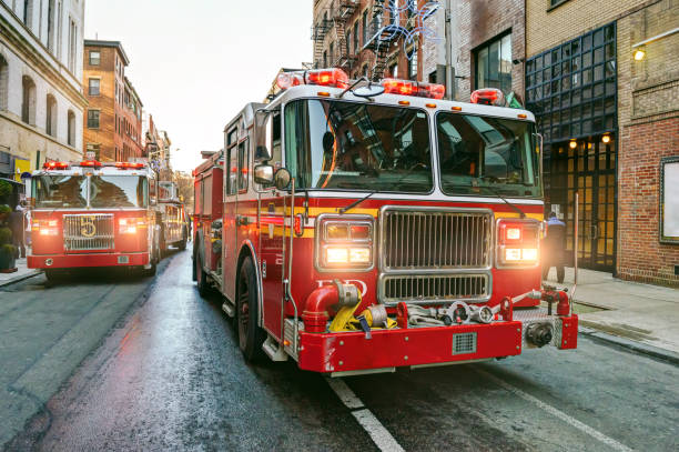 new york fire trucks - firefighter stock photos and pictures