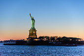 Liberty Statue holding the torch, standing on Liberty Island