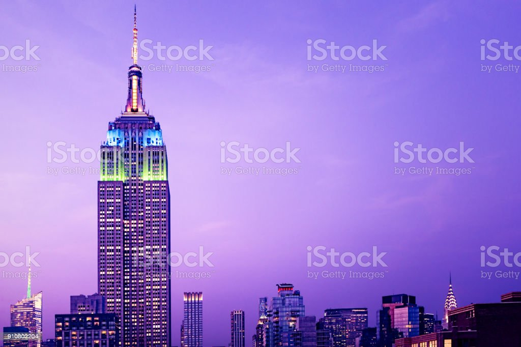 New York High rise buildings at night. Empire State Building in foreground stock photo