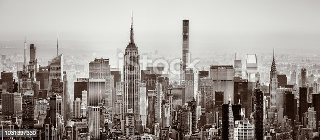 A panoramic toned black and white view of the towers and buildings of Midtown Manhattan from Lower Manhattan.