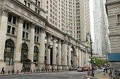 People visit Lower Manhattan in New York. 20 million people live in New York City metropolitan area.